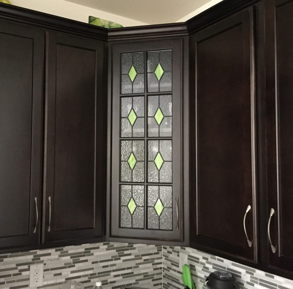 Display That Slightly Displays What S Inside The Cabinet Achieve High End Custom Look For Your Kitchen With A Simple Stained Gl Addition